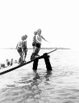 Children line up for their turn on the wooden diving board at Bulcock Beach, ca 1949
