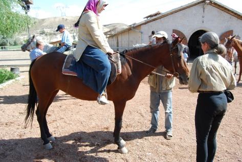 Donna helps out at the ranch, Avanos, 2008.