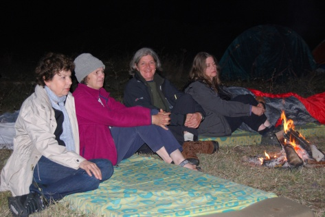 First evening by the camp fire: Thérèse, Caro, Donna and Susan, 2009.