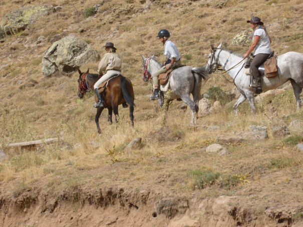 20 August: Donna, Ann and Jude (with Tuvana) pick their way down a rough hillside, en route to Altunhisar